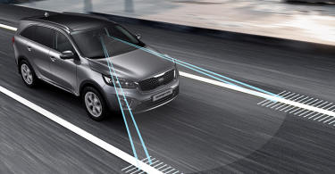 The Kia Sorento features a lane departure warning system that emits an audible alert whenever you stray from your chosen lane. Many manufacturers are now including these safety systems. (Photo credit: Kia.com)