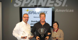 2015 Spanesi Americas Distributor of the Year Chad Neal (center) from Paint Works with Timothy Morgan and Cristina Spanesi.