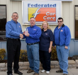 (L to R) – Phil Moore, Federated Auto Parts; Tim Smith and Kim Smith, owners, American & Import Auto Repair; and Kevin Andrade, Fisher Auto Parts.