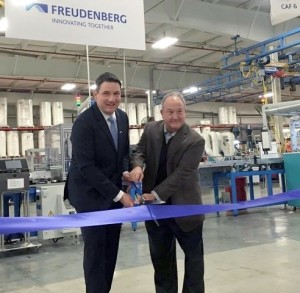 Dr. Erek Speckert, global vice president of operations and Barry Kellar, global vice president of automotive filter, at the opening ceremony of the new cabin air filter production line in Hopkinsville, Kentucky.
