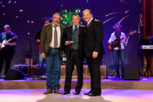 Brian Cunningham, Chad Cunningham and John Kairys at Midas Franchise Award ceremony.