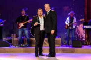 Chris Monteverde and John Kairys at Midas Franchise Award ceremony.