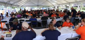 Employees enjoy a barbecue lunch at Airtex headquarters in North Canton, Ohio.