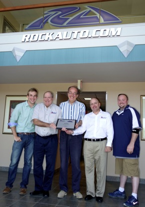 Executives of RockAuto receive Auto 7's 2014 Internet Retailer of the Year award on July 9, 2014. Gathered at RockAuto's offices in Madison, Wis., are, from left: RockAuto Product Manager Ben Sobczak, Auto 7 Senior Vice President Jim Murphey, RockAuto President Jim Taylor, Auto 7 President Steven Kruss and RockAuto Supply Chain Manager David Williams.