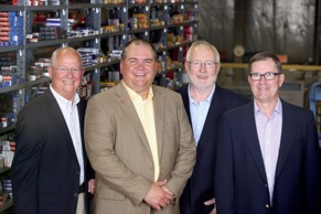 From left: John Bartlett, CEO of APH; Corey Bartlett, president of APH; Dick Beirne, president of United Auto Supply; and Jim Becker, operations manager at United Auto Supply.