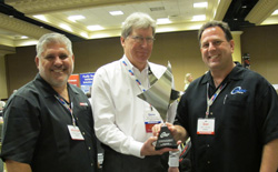 centric president dan lelchuk (right) and vp sales michael musso (left) accept the branded supplier of the year award from apa member gene bochinski (center) of g&h import auto parts.