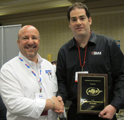 mas industries president mark stermer (right) accepts the headquarters manufacturer of choice award from apa member ben yelowitz (left) of poja warehouse.
