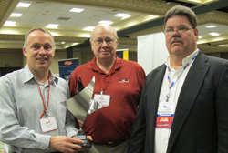 power train components president, jack nihart (left) and hal hultgren (center), national sales manager, accept the professionals' choice vendor of the year award from apa member robert joshlin (right) of speedway auto parts.