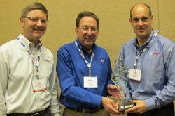 bosch zone manager, joe bergsieker (left) and tim bruin (right), director of sales pdg/traditional channel, accept the marketing partner award from apa president and ceo dan freeman (center).