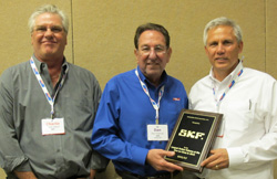 skf's jeff guempel (right), automotive program group sales director, and charlie gilbert (left), regional manager, east, accept the largest total manufacturers' orders at the 2010 one-on-ones award from apa president and ceo dan freeman (center).